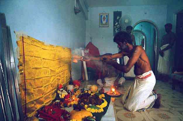 The Itumban puja performed at a devotee's home, marking the end of the festival
