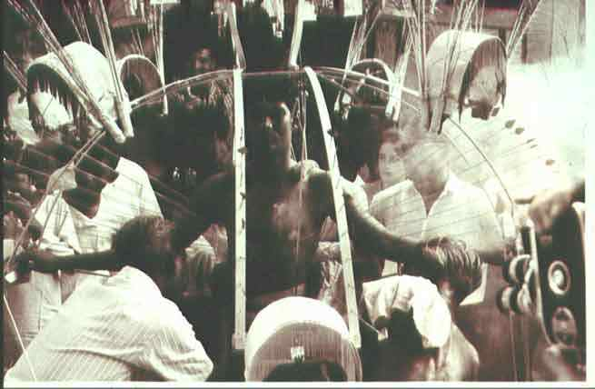 An archival photo of a devotee carrying a kavadi taken in the 1940s