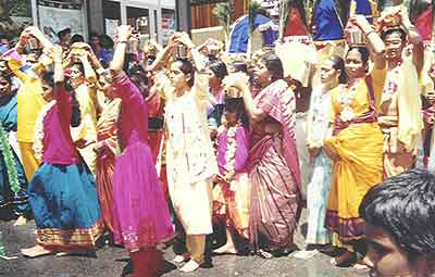 Women devotees carry Pal Kudam in the Taippoosam Kavadi procession